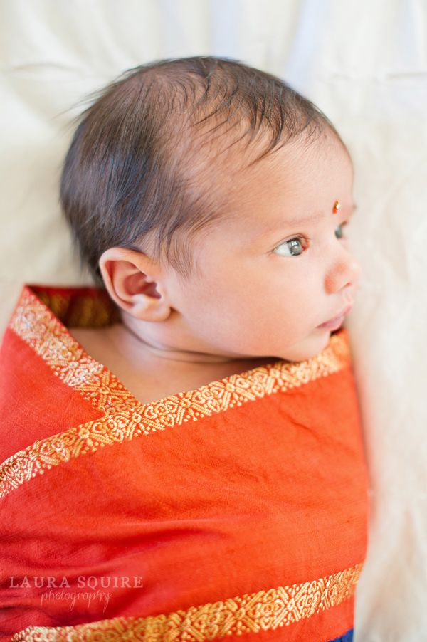 Indian baby wrapped in a Sari