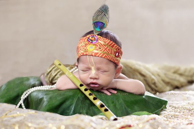 Baby as Bal Krishna with flute