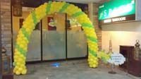 Green and Yellow balloon arch