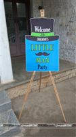 Welcome to Johanns Little Man Party - Entrance board setup on a wooden easel