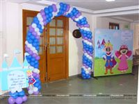 A royal entrance to a Prince theme birthday party with a castle cutout with a welcome message and a photo booth for all the little princes and princesses.