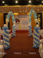 Royal walkway to a Little Prince theme birthday party stage with an archway using floating helium balloons on either side